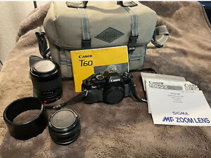 Used Canon T60 35mm SLR w/50mm Canon & 70-210mm Sigma Lenses, manuals & case
