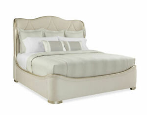 Sleigh bed in cream velvet and cream upholstery