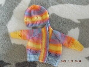 hand knitted new born babies cardigan, and hat, set.