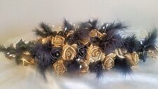 TOP TABLE WEDDING FLOWER ARRANGEMENT IN GOLD & BLACK WITH  FEATHERS AND PEARLS