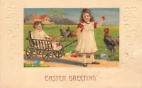 Easter Postcard Girl Pulling Baby Sister in Wagon Colored Eggs Chickens~126367