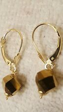 14k yellow gold earrings with a fancy Gold colored stone