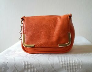 Therapy orange faux leather small shoulder bag