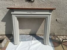 Wood fire surround used