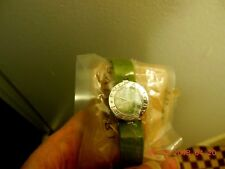 Women Bulgari watch green leather wrist band and mother Perl face