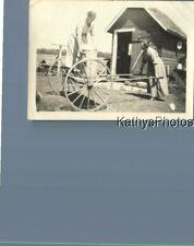 Found B&W Photo K_2688 Womani Pushing Other In Wagon