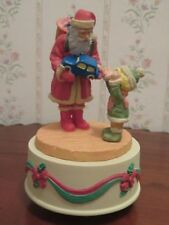 Santa Rotating Music Box  Giving a Young Boy a Toy Car