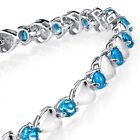 925 Sterling Silver Blue Topaz Heart Shaped Cubic Zirconia Puff Tennis Bracelet