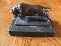 Bronze figure of a charging bull on a marble base