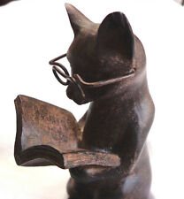 Young Inc. resin cat reading book