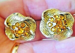 GOLD TONE CLIP ON STUD EARRINGS WITH ORANGE CRYSTALS IN CENTRE