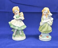 TWO CUTE YOUNG GIRL FIGURINES - A GIRL CUDDLING A CAT & A GIRL CUDDLING A PUPPY