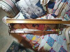 "Lwood wall shelf, plate grooves, brass ends, 30"" x 5 1/2"" x 8"", metal hooks used"
