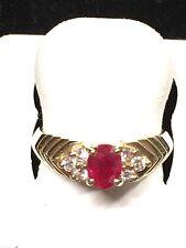 LADIES RUBY + DIAMOND RING/OVALSHAPED STONE