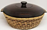 Anchor Hocking 138 amber casserole with lid in wicker basket. 2 qt.
