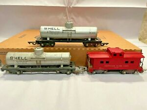 Gilbert American Flyer S Gauge 625 Silver Shell Tank (2) and a 638 Caboose