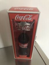 Coca Cola collectors bottle of coke with opener