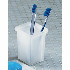 A contemporary square white glass frosted glass free standing toothbrush holder