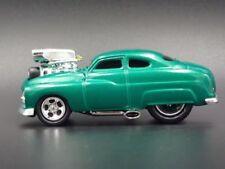 Modellini statici di auto, furgoni e camion verde Mercury