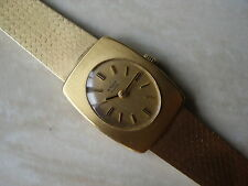 LADYS 18 CARAT GOLD WYLER WRIST WATCH WITH AN INTEGRAL BRACELET