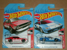 Two 1/64 Scale Police Car Diecast Vehicles - Countach Skyline - Hot Wheels