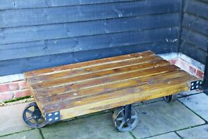 Steampunk industrial rustic vintage cart / trolley coffee table with planked top