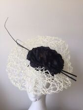 Stunning NEW cream and black basket weave fascinator on a headband.