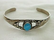 vintage silver Navajo style torque bangle with turquoise stone