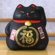 A Maneki Neko Feng Shui Lucky black cat for protection – medium size