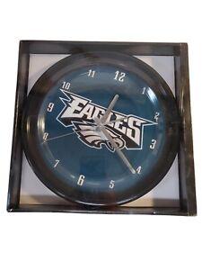 Philadelphia Eagles NFL Football Clock, black rim,  battery operated, new in box