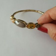 A Lovely Gold tone Bangle With Coloured Stones