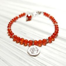 CARNELIAN AND HILL TRIBE OHM CHARM STERLING SILVER BRACELET