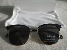 Polaroid gold / black gold frame polarized sunglasses. PLD 4055/S. With case.