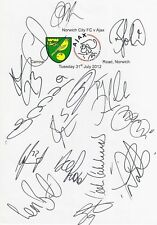 An A4 white card with the Norwich City Badge. Signed by 15 players on 31.07.2012