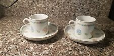 Set of Two Blue and Pink Flowered Demitasse Cup and Saucer marked