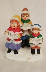 Lemax - Dept 56 - Other. Porcelain Choir Figurine of 3 Children.