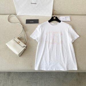 NWT $1200 CHANEL Summer Runway Floral Print CC Logo TOP Glitter T-SHIRT White