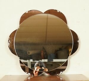STUNNING 1930's AMBER/PEACH IN SHAPE OF A FLOWER BEVELLED MIRROR