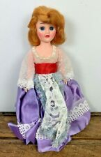 Vintage Caucasian Doll Golden Hair Eyes Move Purple Dress