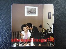Vtg 70s Living Room Photo Of Man Giving Side Hug&Kissing Woman On The Cheek P185