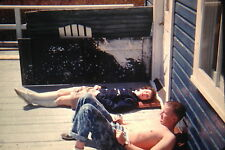 KODACHROME Red Border 35mm Slide Man Woman Sunbathing On Porch Smoking 1950s!!!