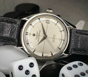 Late 1950s Stainless Universal Geneve Polerouter Date, Silver dial, cal 215-1