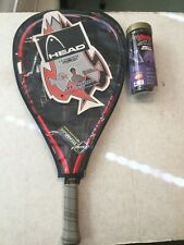 Head Titanium Racquet ball racquet and a package of balls
