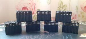 Dolls house black wooden blocks of books