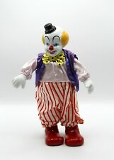 Unique musical moving wind up clown with porcelain Head and hands.