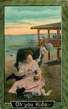 OH YOU KIDO MAN & WOMAN ON BEACH WITH SAND BUCKET TOYS ROMANCE POSTCARD c1910s