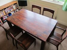 A Rosewood Dining Table with Spectacular Grain that Seats Six