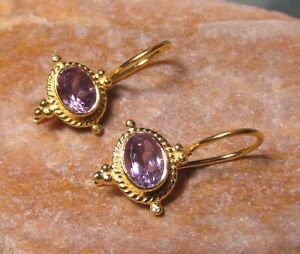 Sterling silver with 18k gold plate cut AMETHYST gemstone earrings.