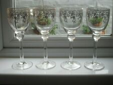 4 large, wine glasses with gold filigree pattern
