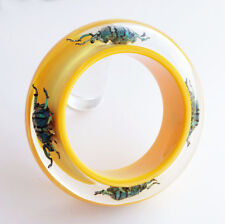 Fun bright yellow lucite bracelet with four real insects by Kolos Designs